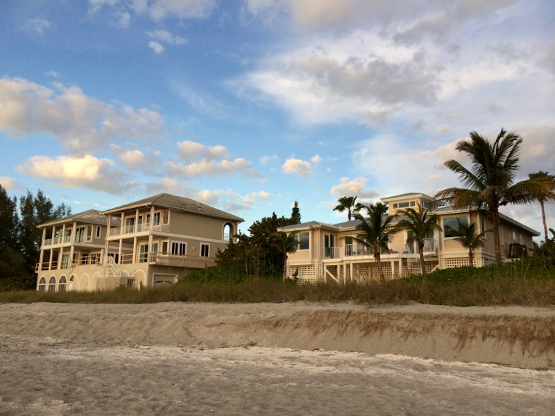 Exterior Photo of a White Beach House from the sand